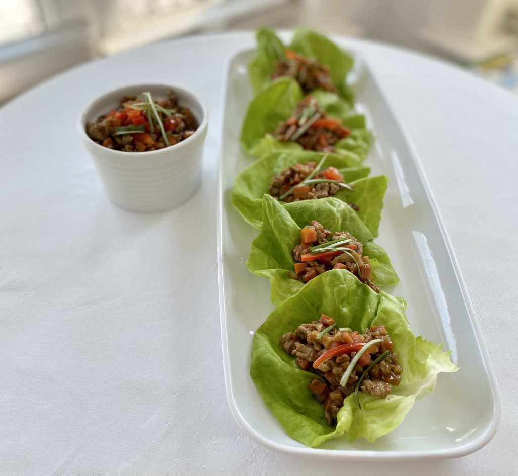 chicken lettuce wraps on a long white platter