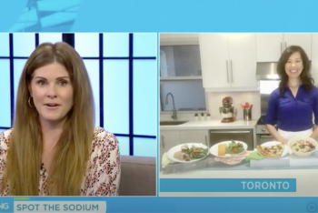 TV host chatting with Sue Mah in her kitchen